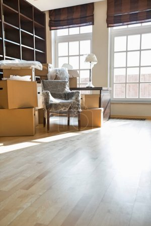 Photo for Cardboard boxes and furniture in new home - Royalty Free Image