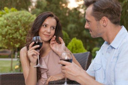 Loving couple having red wine
