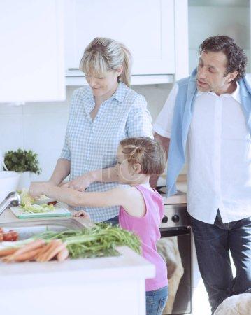 Family making healthy salad