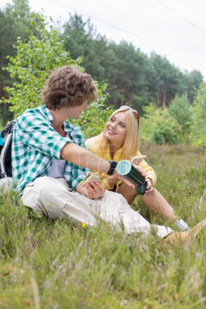 Couple relaxing in field