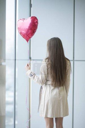 Woman holding air balloon