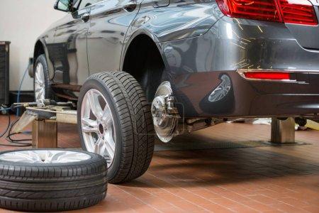Car and tires at repair shop