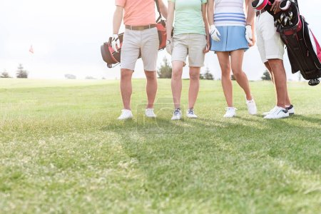friends standing at golf course