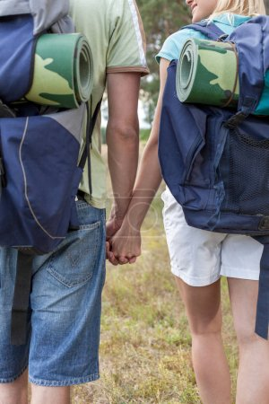 Backpackers holding hands