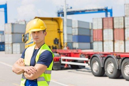 Man in shipping yard