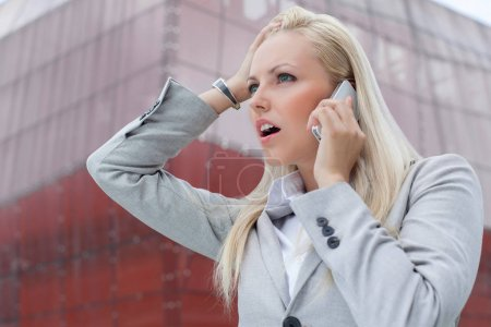Businesswoman communicating on cell phone