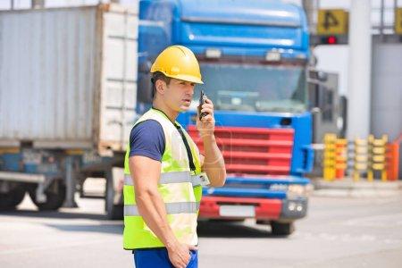 Man using walkie-talkie