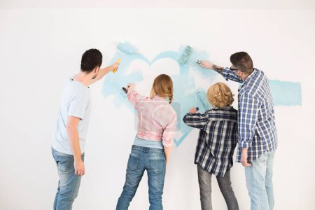Couples painting wall