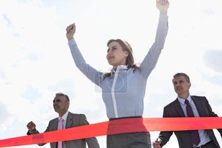 Businesswoman crossing finishing lin