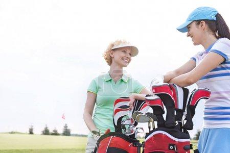 Happy female golfers