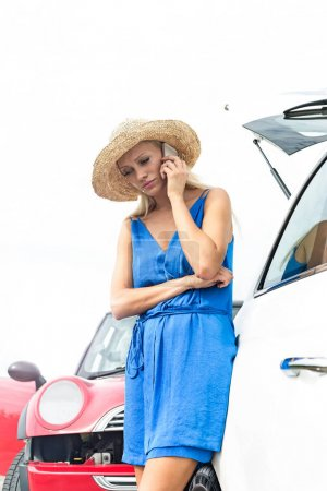 woman by broken down cars