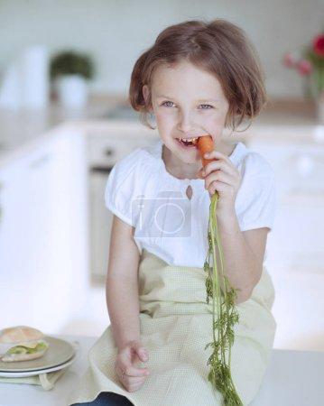 Girl eating carrot