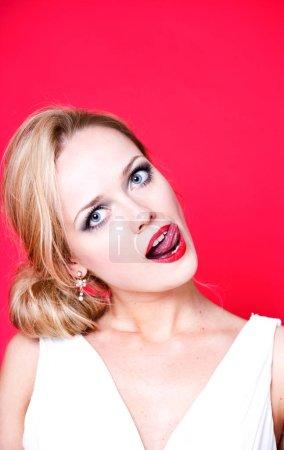 Caucasian woman licking her lips
