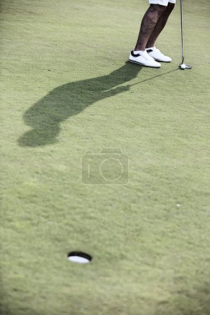 Man playing golf at course