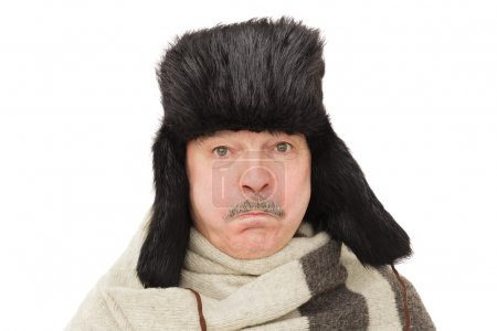 Pensioner in russian traditional hat