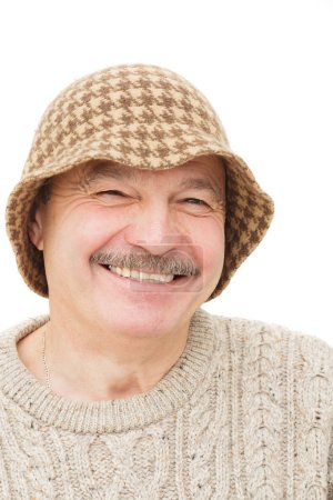Satisfied and happy elderly man in a funny hat