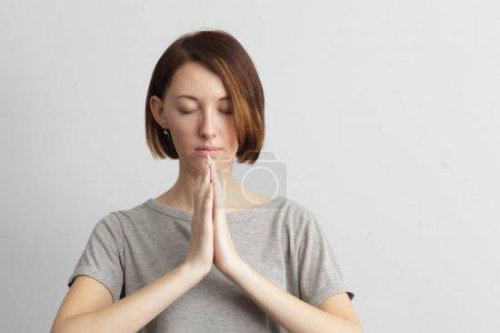 Girl holding hands together, meditating