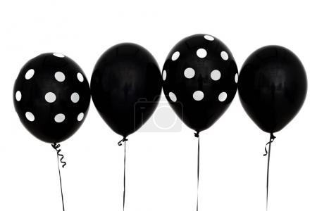 Black inflatable balls for a sad holiday. Depression and sadness