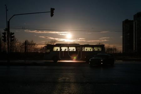 Silhouette of a city bus