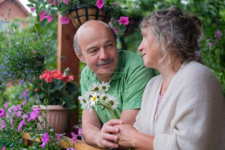 Cheerful senior couple enjoying life at countryside house