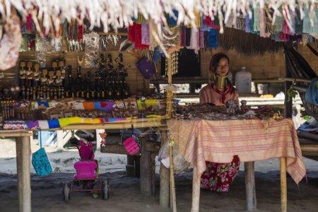 CHIANG RAI, THAILAND - NOVEMBER 4 2017: Unidentified Long Neck Karen hill tribe woman selling folk art goods