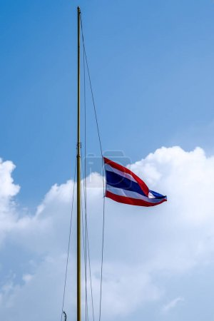 Waving Thai flag of Thailand with blue sky