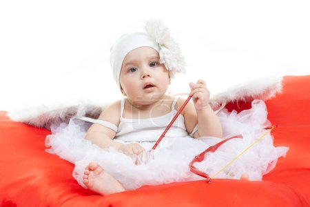 Photo for Happy Valentines Day. Angel baby from heaven at the big red heart. Cupid in white wings with bow and arrows in studio at white background. - Royalty Free Image