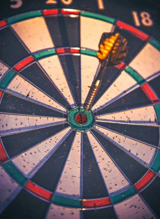dart in the center bulls eye circle