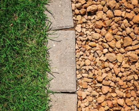 grass bricks and stone landscaping in a nice manicured yard good