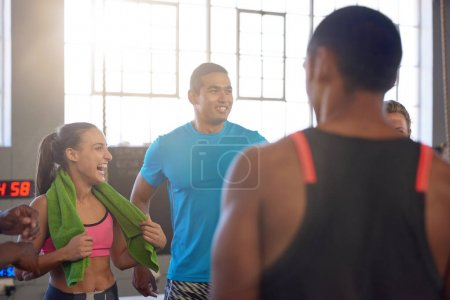 sportive people laughing in gym