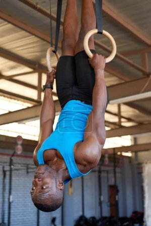 man working out with gymnastic rings