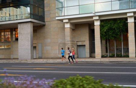 sportive people jogging on road