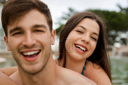 Woman embracing man inside pool
