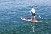 man practicing paddle