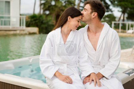 Young couple sitting in bathrobes