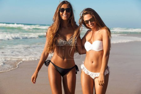 Beautiful girls walking on beach