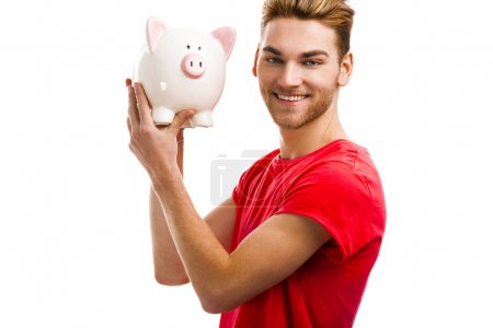 Handsome young holding a piggy bank
