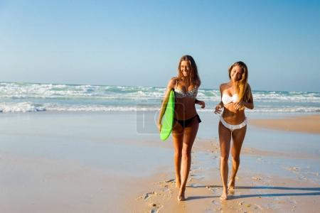 beautiful girls  with a surfboard