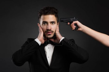 young man with a weapon