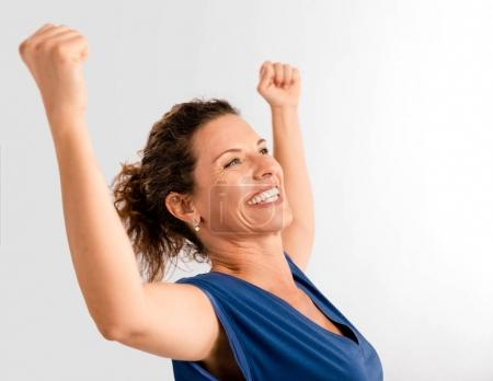 woman with arms up expressing victory