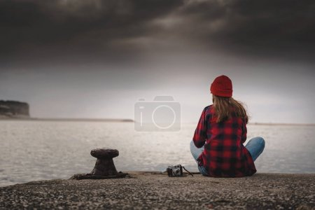 Photo for Beautiful woman enjoying her day in the lake with a mug of hot coffee - Royalty Free Image