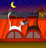 Lovers cats sitting on the red roof under the moon on a background of the city at night