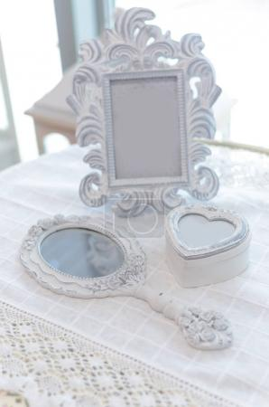 Beautiful vintage carved mirror on the table