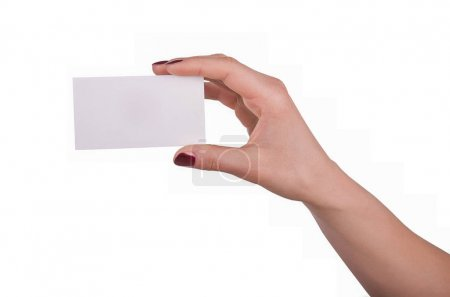 Photo for Well-groomed female hand with manicure and red lacquer holding an empty white card, isolated on white background - Royalty Free Image