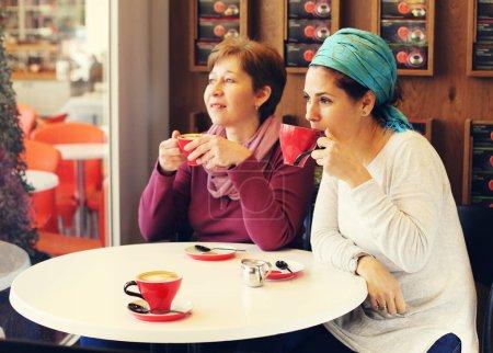 happy women sitting in cafe
