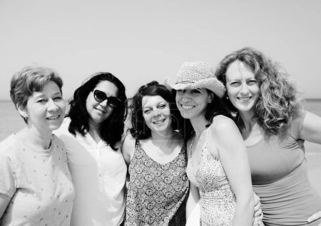 Photo for Portrait of five mature women posing on seaside - Royalty Free Image