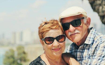Portrait of senior couple walking outdoors