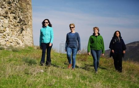 Outdoor portrait of happy 40 years old woman traveling together