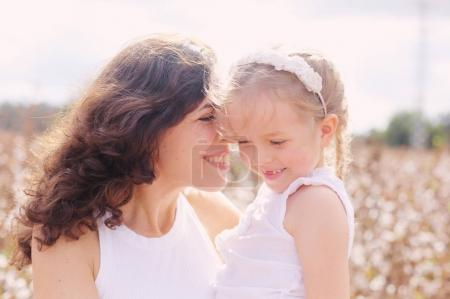 Portrait of beautiful mother with two daughters outdoors