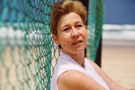mature woman sitting on seaside